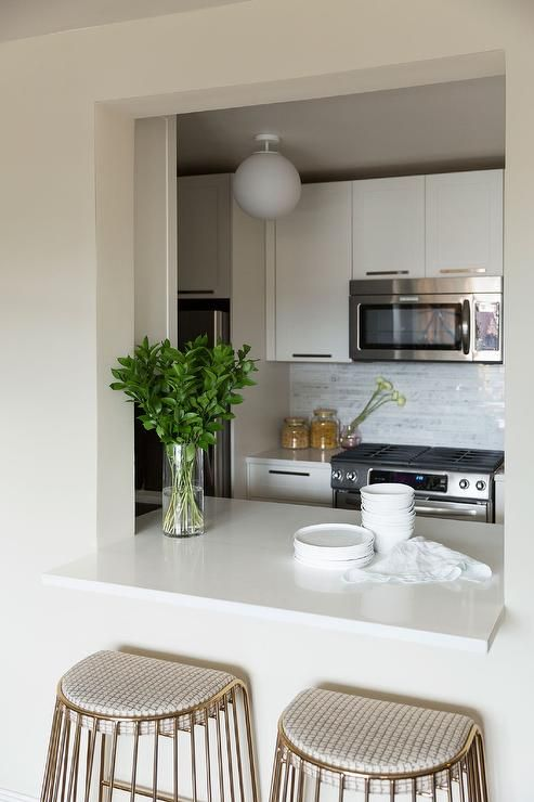 Chic Kitchen Boasts White Cabinets Paired With White Quartz Countertops And  A Linear Marble Tiled Backsplash Part 86