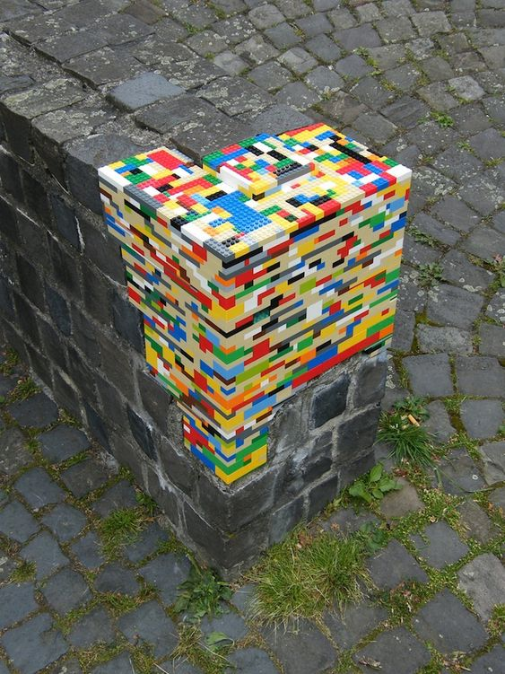 using bricks to repair a wall - there are loads of nice photos out there for lego street art