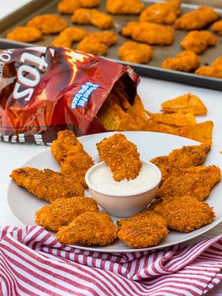 Doritos Crusted Chicken Fingers - Marinate sliced boneless chicken breasts in buttermilk for 2 hours. Dredge in flour. Dip in egg wash.  Dredge in crushed Doritos. Bake in a 400F for 15-20 minutes.:
