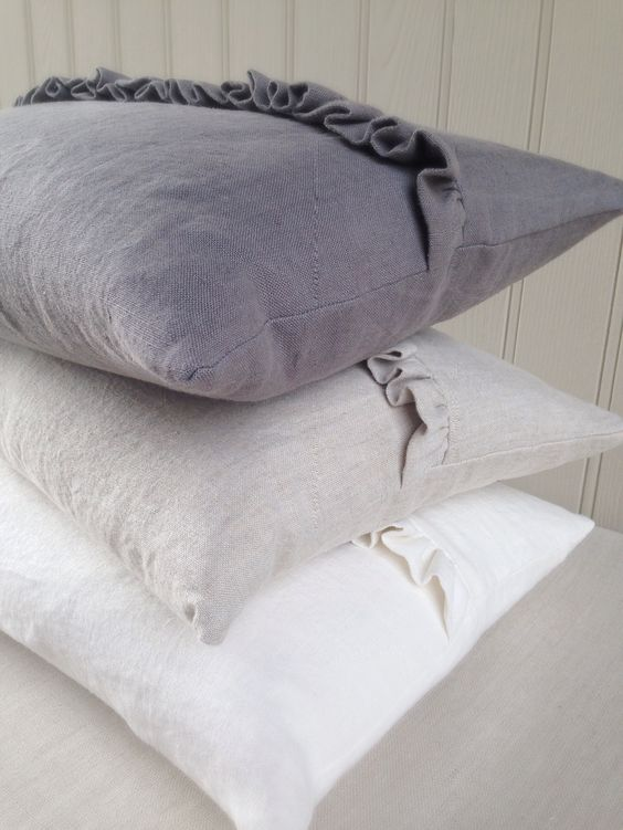 Beautiful plain linens finca frills cushions handmade by Clarabelle Interiors in Peony and Sage Linens. Mule, Stone & White