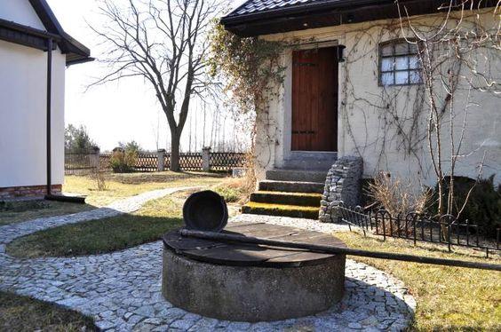 DOM POD LASEM: styl Wiejski, w kategorii Ogród zaprojektowany przez Grzegorz Popiołek Projektowanie Wnętrz