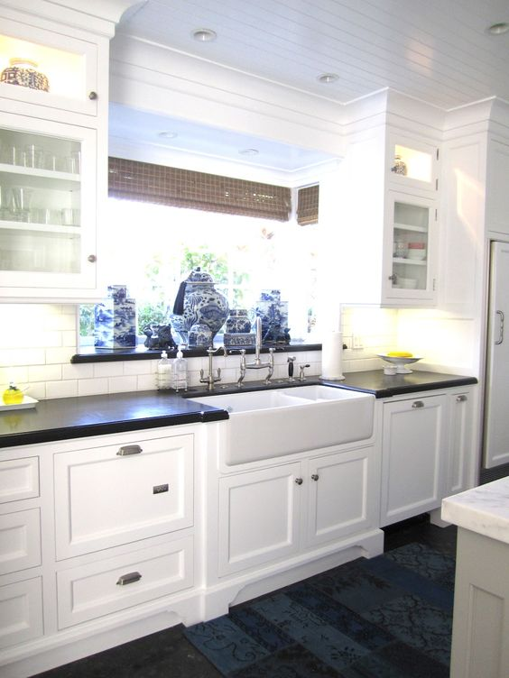 white cabinets black countertops hardwood floors: