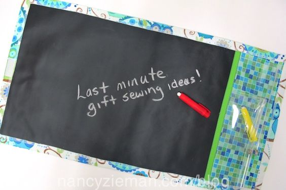 Sew a super easy gift for little kids -- it's a chalkboard roll-up? Take to a restaurant, church, or wherever to encourage quiet kids. Rolls up for storage transport.: