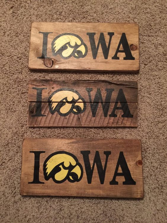 This hand-painted Iowa sign made from re-claimed wood would be a great  addition to any Hawkeye fans' home. The sign is x - Reclaimed Wood Iowa Hawkeye Sign; Iowa Sign; Iowa Wood Sign
