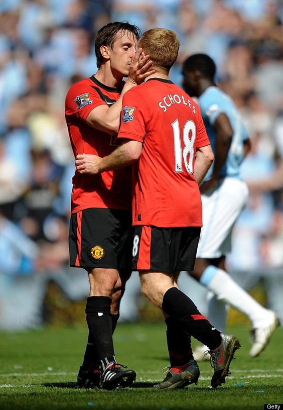 Gary Neville and Paul Scholes share a tender moment.
