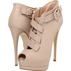 Giuseppe Zanotti  ++++  Place a dominating spin on your style with these killer booties.