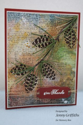 handmade Thanksgiving card with a grunge look ... book print paper with watercolor washe in slightly muddy colors ... Memory Box pinecone branch with main image removed in a delightful switch from the normal die cut ... dark brown background paper shows through the negative space pinecones ... luv it!