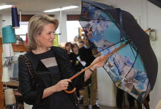 Princess Mathilde of Belgium opens an umbrella during a visit at the ENSAV Arts Academy in Brussels