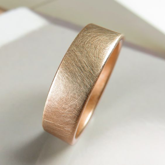 6mm brushed rose gold 14k wedding band handmade by Spexton. This seamless band is stronger than ordinary gold rings that are cast or made from wire.:
