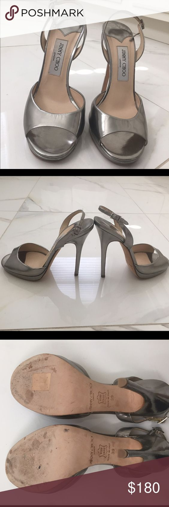 Authentic Jimmy Choo metallic silver stilettos Authentic Jimmy Choo platform heels. Size 39. Very good shape- purchased at sample sale and I have only worn once as the heel is too high for me. Some dentations back of heels (see pictures). Jimmy Choo Shoes Heels