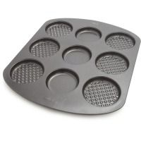 Wilton® Egg Sandwich Pan  New Say goodbye to the drive-thru, this pan makes breakfast fun and easy. Inventive nonstick pan lets you bake waffle tops and bottoms—plus eggs—for three tasty morning meals. Simply crack an egg into the center mold and pour your favorite waffle ...