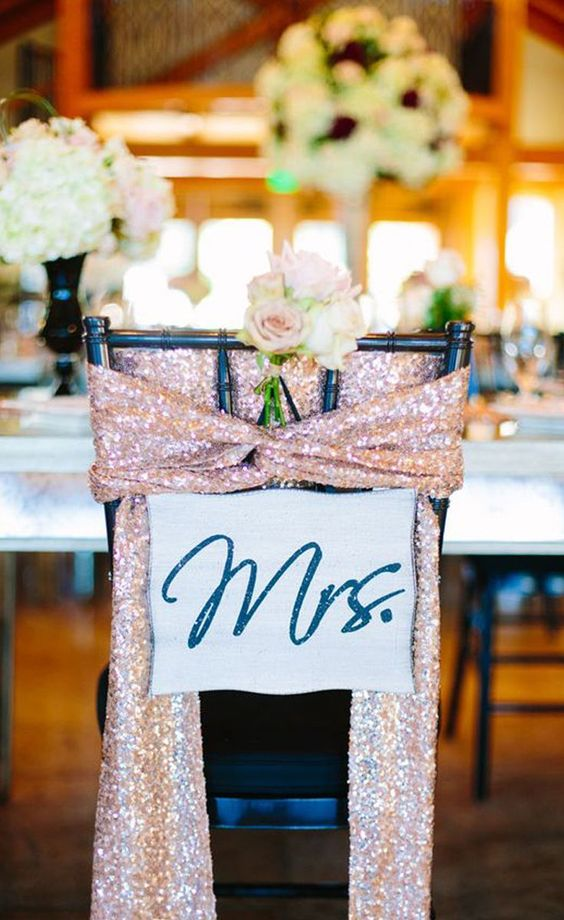 Pick up some sparkly rose gold fabric and wrap it around the bride and groom's chairs to set them apart from the rest. | Rose Gold Chair Sashes | 8 Decor Ideas for a Rose Gold Wedding | My Wedding Favors