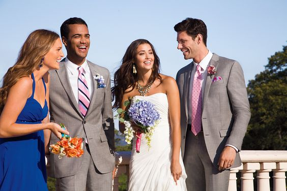 A skyline-soaked vista is the perfect backdrop for this free-spirited affair. #menswearhouse #weddings
