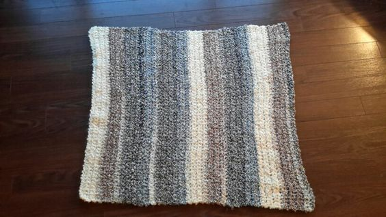 Lion Brand (Homespun Thick & Quick) super bulky #6. Colour is called Granite Stripes. The pattern is super easy just a single crochet!