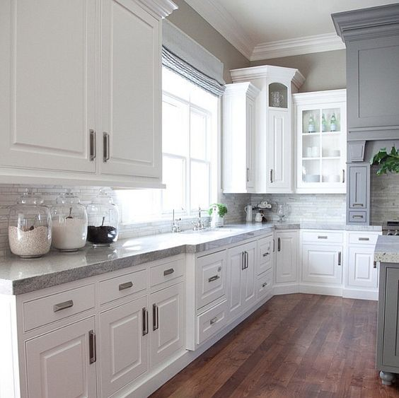 White and gray kitchen countertop. The gray is Benjamin Moore Dolphin. The counter in this white and gray kitchen are Delicatus Granite. #DelicatusGranite #WhiteGrayKitchen #BenjaminMooreDolphin Alice Lane Home Collection
