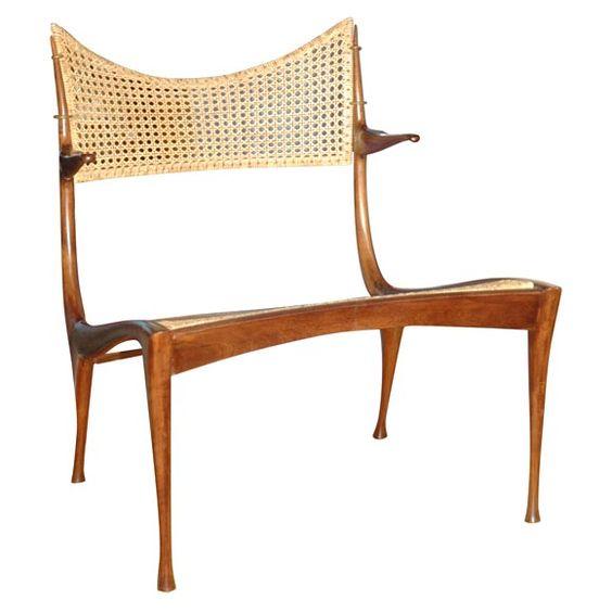 Dan Johnson walnut and cane arm chairs, USA, 1960s.