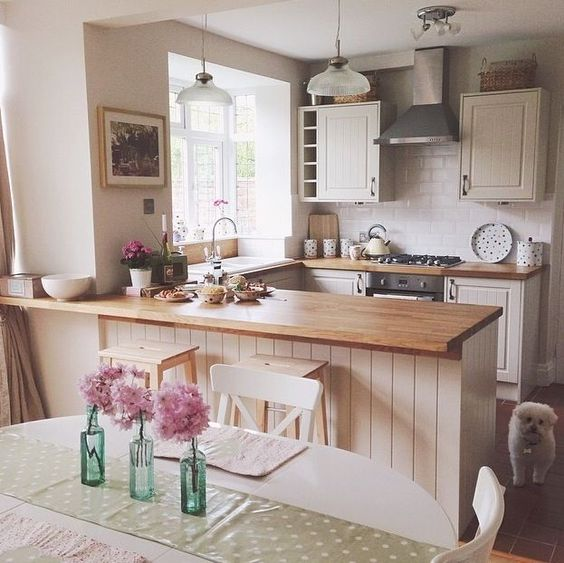 kitchen with cream cupboards and wooden worktops. Emma Bridgwater accessories add a hint of country charm.: