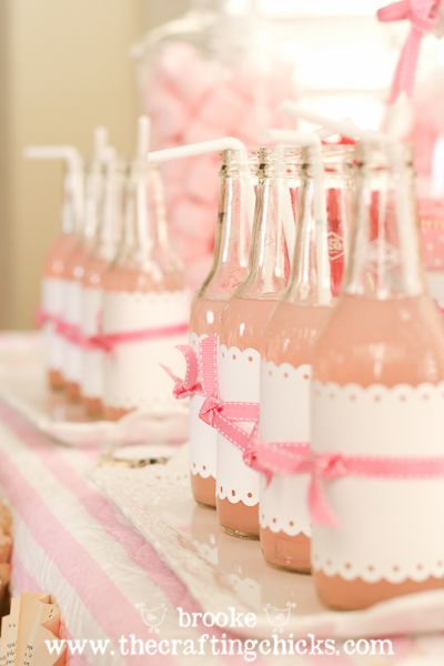 Use clear bottles, remove labels, place in dishwasher to clean them up.   Use a scalloped edge paper punch to add a decorative touch to the paper for the new label. Fancy Pink Drink!