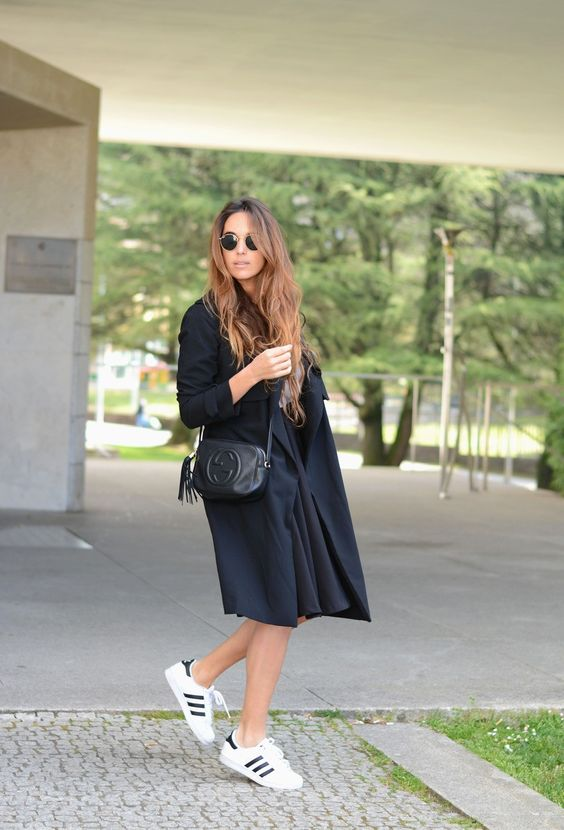 Stella Wants To Die is wearing a black Bershka skirt with the trench coat from Pull & Bear and Adidas Superstar sneakers