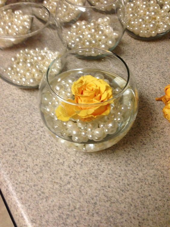 Hand making decor for my wedding.   Glass bowls from Hobby Lobby  Yellow Roses from SaveonCrafts  Pearls from Oriental Trading Company