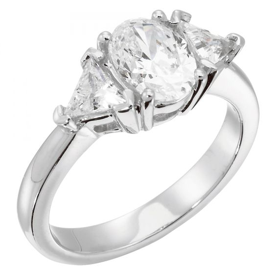 This twist on a three-stone ring is simultaneously vintage and modern. The smooth band flows into two Triangle cut Contemporary Nexus Diamond™ accents, which flank the center stone to create a unique shape reminiscent of an East-West style ring. The look is excellent for both slender and wider fingers, as it elongates the hand on which it sits.  Center stone is available in a variety of carat weights; choose yours from the menu above. Two Triangle cut Nexus Diamond accent stones. Complete…