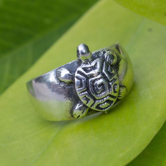 A sea turtle ventures onto a beach of silver sand in a toe ring by Wadarat Supasirisuk. Patient and purposeful, the sea creature pauses on this trendy toe ring handcrafted of sterling silver.