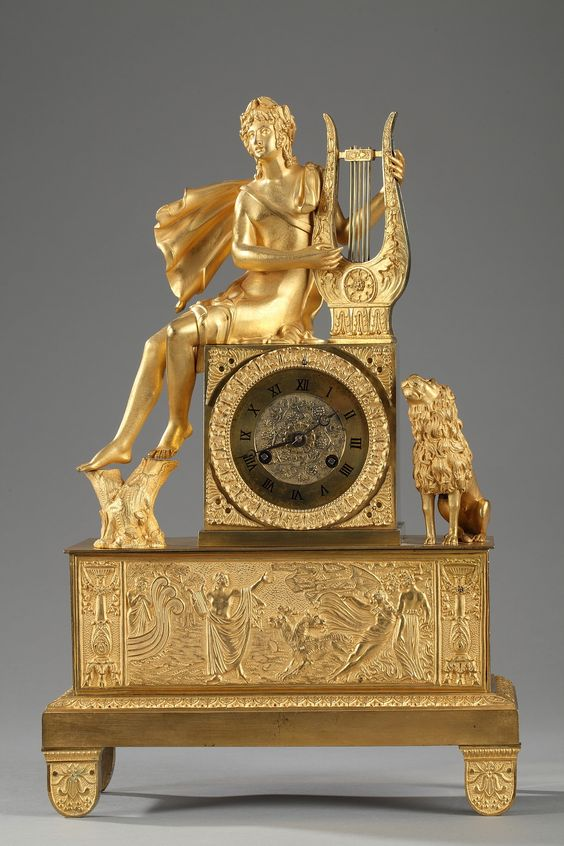 Early 19th century gilt and chiseled bronze mantel clock. It features Orpheus…