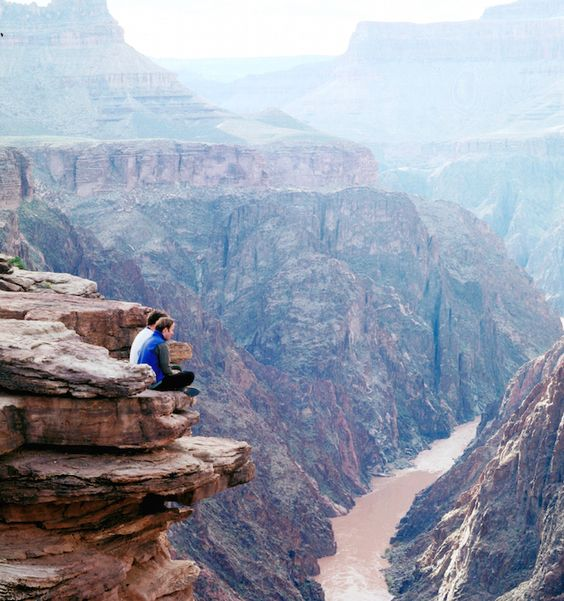 Sitting on the edge of the Grand Canyon is an awesome and awe-inspiring experience.