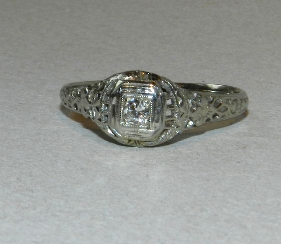 Antique Engagement Ring, 18K White Gold, Hand Cut Antique Diamond, Authentic Art Deco circa 1920s. $589.00, via Etsy.