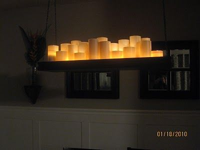 DIY Candle Chandelier:   Total Cost: $32.50 Cups: $12 (1.92 for a 4 pack at WalMart) Contact Paper $6 Scrap wood $0.50 Trim - $7 Hardware (chain and hooks) $7