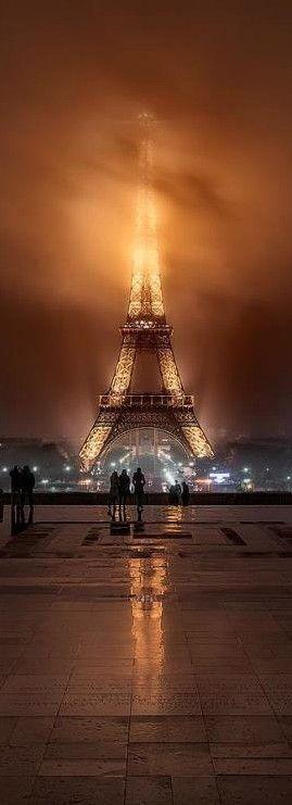 Foggy night at the Eiffel Tower in Paris • breath taking!