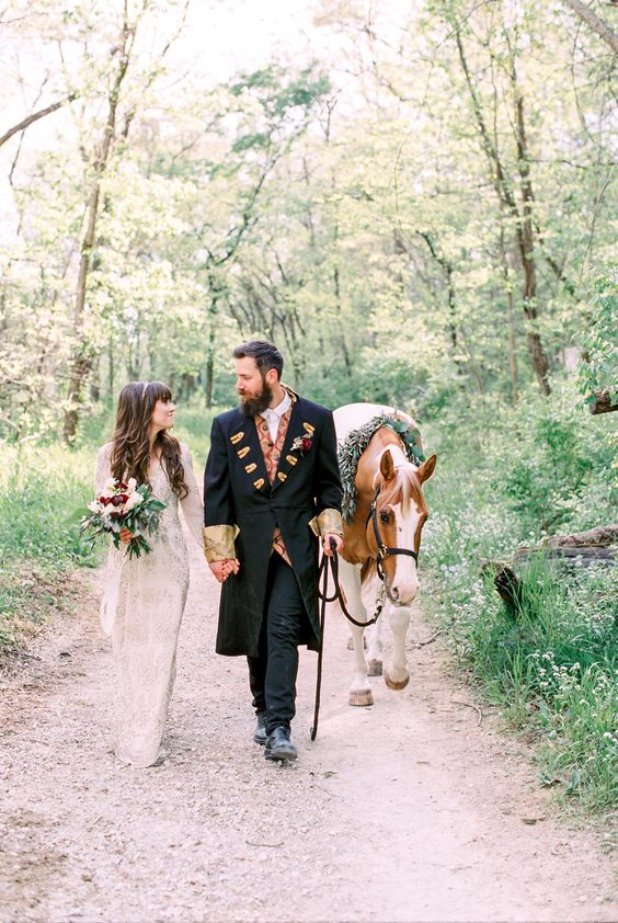 horses at weddings - photo by Laura Ann Miller Photography http://ruffledblog.com/royalty-inspired-wedding-ideas-at-a-castle