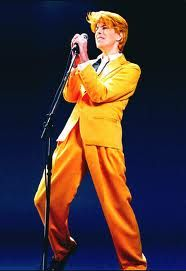 Bowie singing in mustard