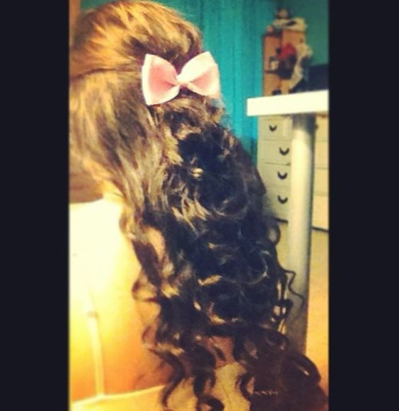Curled hair with a bow added! Done by myself!