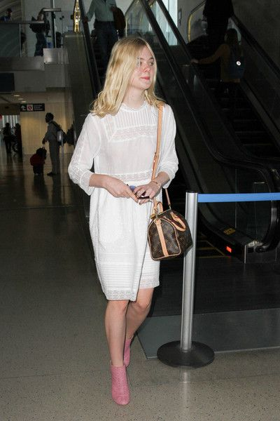Elle Fanning Photos Photos - Elle Fanning is seen hitching a flight at LAX on September 2, 2015. - Elle Fanning Hitches a Flight at LAX