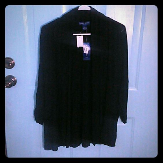 Black over sweater Beautiful over sweater Half length sleeves Sleeves cinch and ends 2 front pockets Should to end length :  29 in Armpit to armpit :  22 in Sleeve length 15 in STRETCHY Karen Scott Sweaters Shrugs & Ponchos