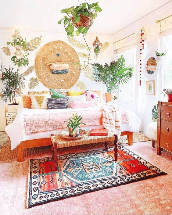 Bohemian living room loaded up with shading! Mooring the space are colorful bohemian elements including bright shaded carpet and a lot of shades in form of bean bags. Bright sheet material including the cushions pulls together the various yummy shades enlightening the room.