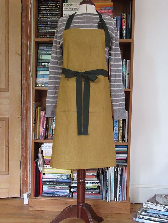 Custom order for Much Ado Books. Ochre denim aprons with dark green ties