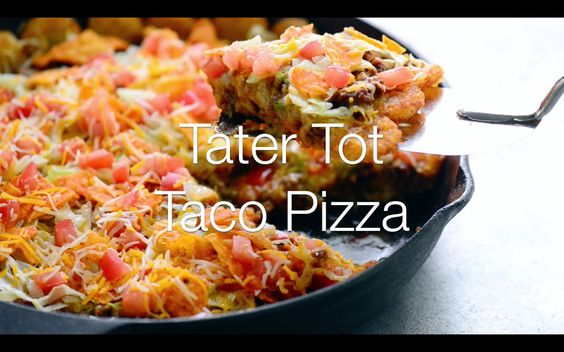 Tater Tot Taco Pizza is a mouthwatering combo of two of your favorite eats: tacos and pizza! The tater tot crust makes this dinner recipe even more fun.