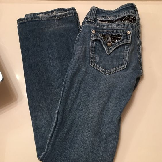 Miss Me medium wash denim jeweled pockets Button pocket with black lace and jewels boot leg slim fit double button on waistline length 31 from crotch to bottom inseam 7 waist 26 Miss Me Jeans