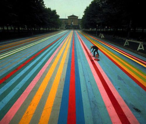 Photo by Henry Groskinsky. Artist Gene Davis painting the street leading up to the Philadelphia Museum of Art in 1972.