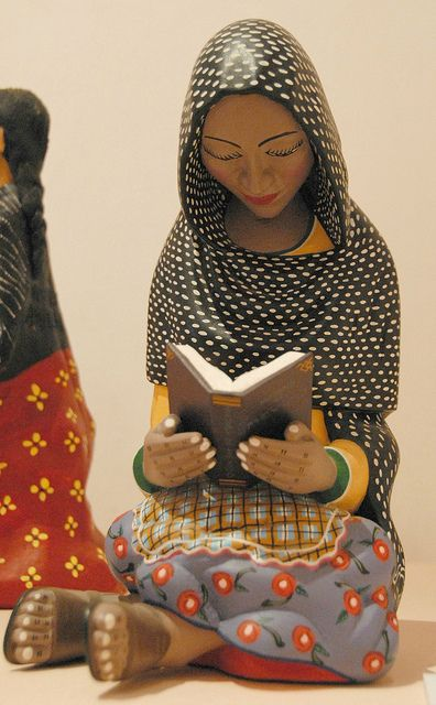 Woman Reading Mexico | photo by Karen Elwell | A Oaxacan woman in a rebozo reads a book. Wood carving from the collection of Rosa Klum that was displayed at a library in the city of Oaxaca, Mexico. I don't have the name of the artist who made this lovely sculpture.