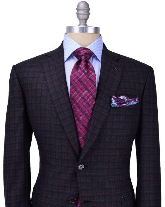 Brioni Charcoal with Red Check Sportcoat 	2 button jacket 	Black melton 	Bordeaux lining 	Fully lined 	Notch lapel 	Flap pockets 	Double vent 	Drop: 6 	100% wool 	Made in Italy