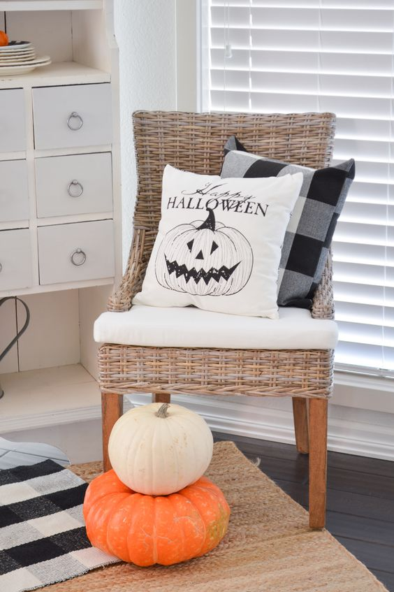 Haunted Halloween Decorating in the Sun Room - Cottage home decorating in orange and black, Happy Halloween Pillow Cover #farmhousehalloween #halloweendecor #halloweendecorating #halloweendecoratingideas #blackandorange #classichalloween #vintagehalloween