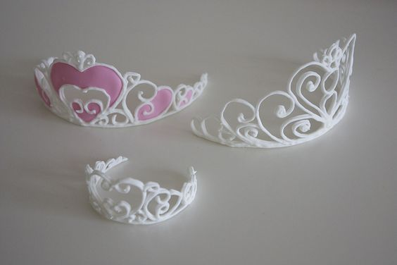 Royal icing tiara's by RedNalie, via Flickr: