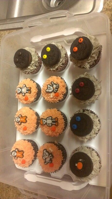 Basic halloween cupcakes with oreos nd mini m&m's.