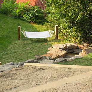 Put some stakes in the ground to make a lounging trio of hammocks.   51 Budget Backyard DIYs That Are Borderline Genius