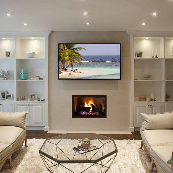 Spacious Living Room With Wall Integrated Fireplace And Mounted Tv Spacious Living Room Fireplace Family Room Design