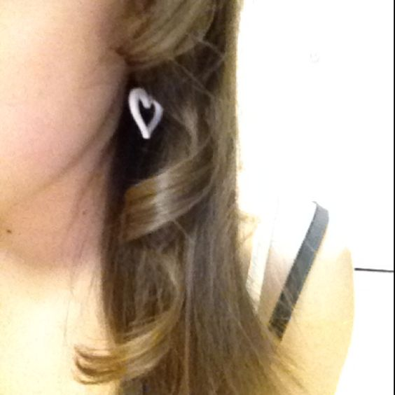 The perfect curl among straight hair. And this curl was made with a straightener.