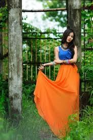 Google Image Result for http://images3.chictopia.com/photos/France_Anhphuong142/7945563326/orange-long-skirt-skirt-blue-top_400.jpg